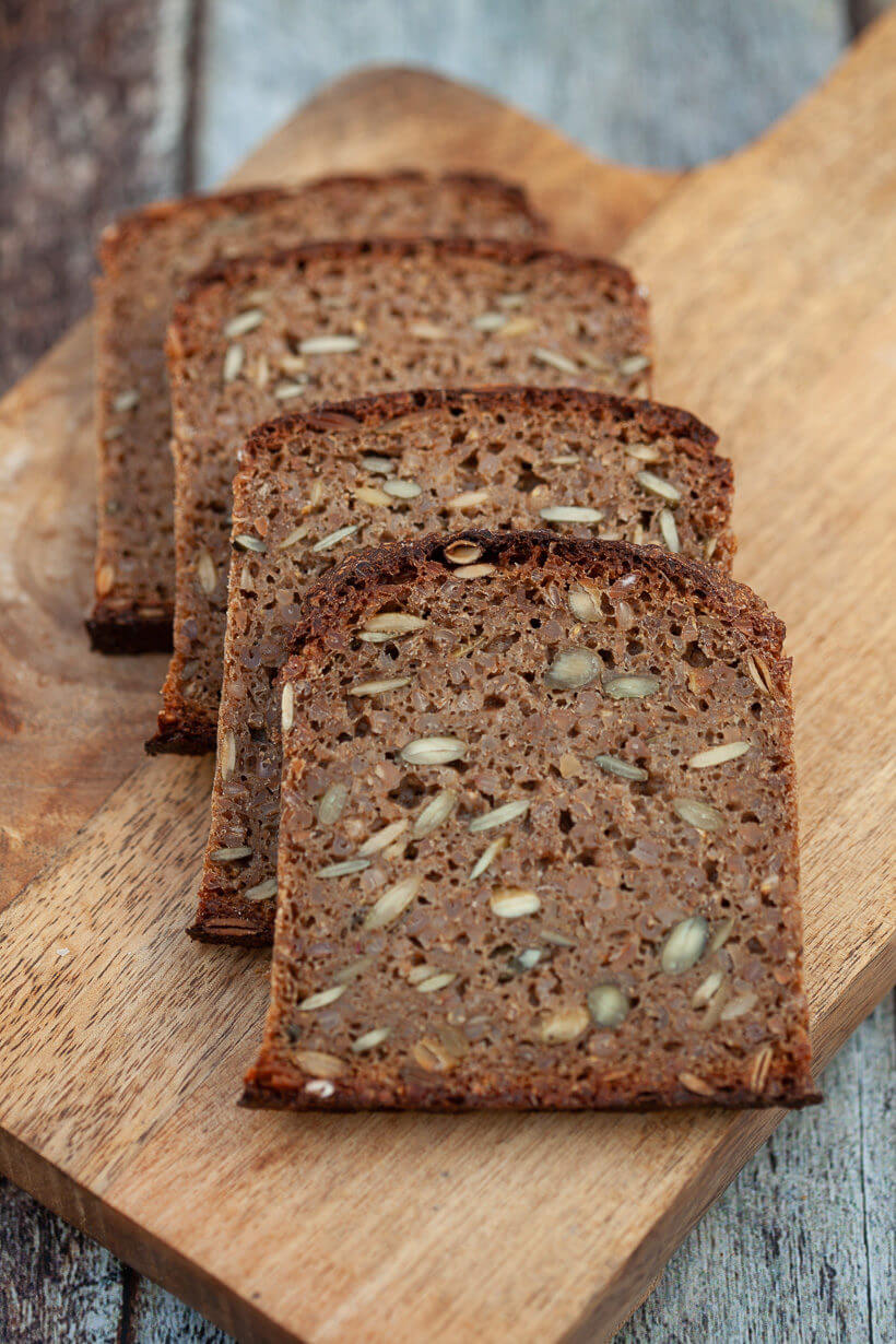 Four pieces of rye bread on a board - Soft crumb with lots of seeds