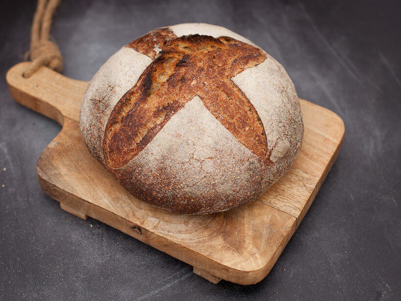 The cross achieves a gorgeous loaf with sourdough bread scoring