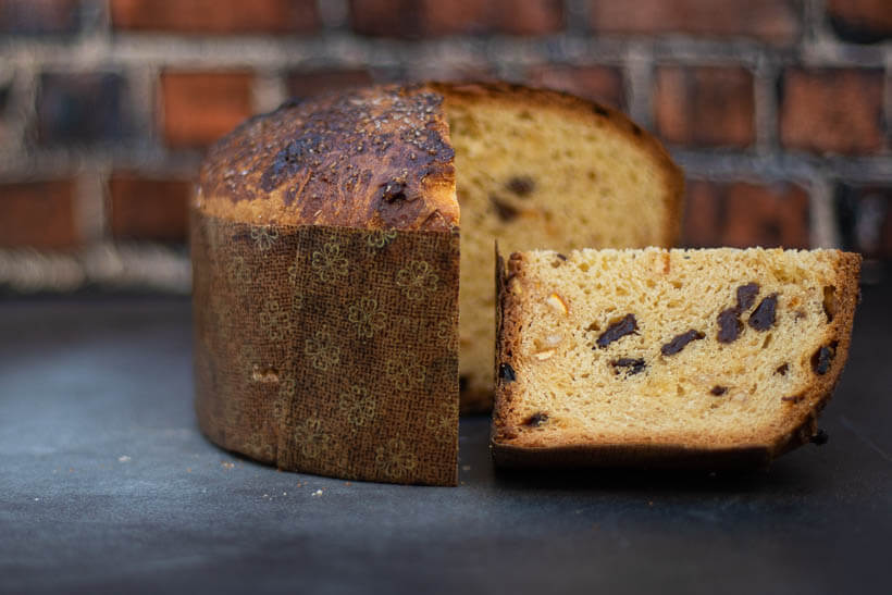 Super easy sourdough panettone recipe with a slice cut out showing the gorgeous and fluffy crumb