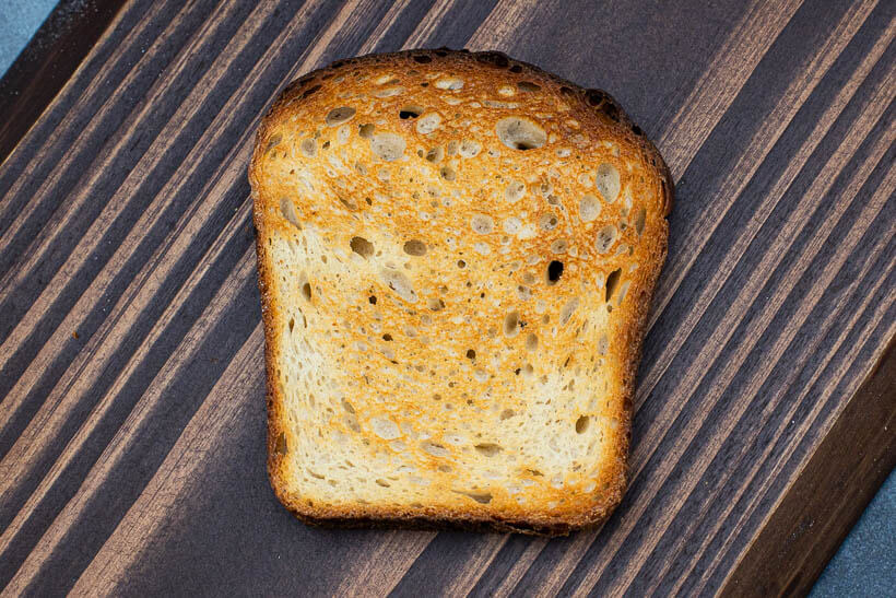 Toasted piece of sourdough sandwich bread.