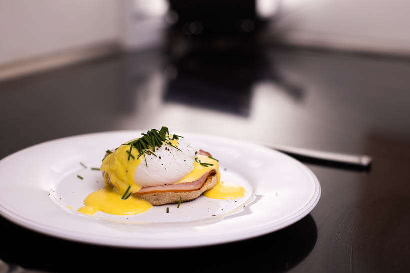 Perfect eggs benedict on a plate. Ready to eat.