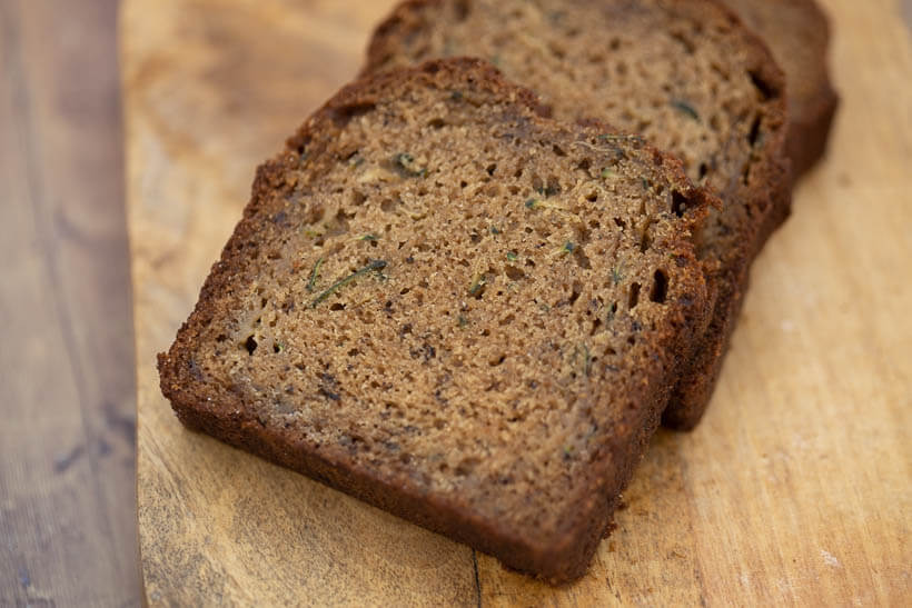 slices of zucchini bread on a wooden board
