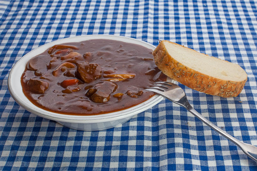 Hungarian goulash in a bowl with a piece of delicious bread!